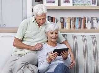 senior couple viewing iPad