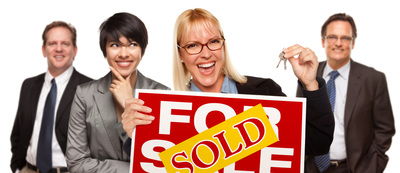 realtors with sold sign
